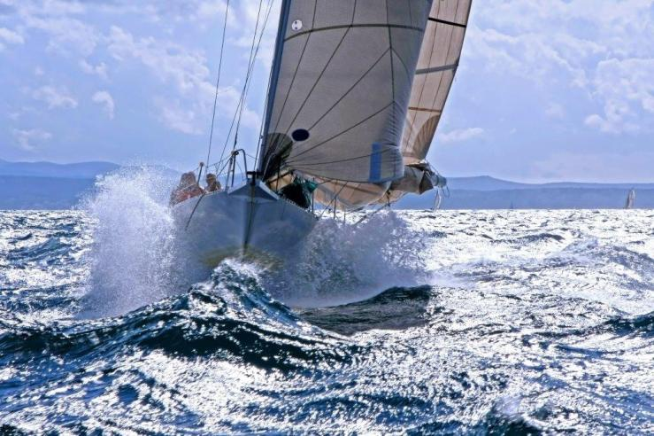 Sailboat in rough seas shutterstock_760569223